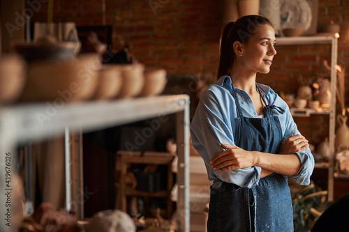 Fotografie, Obraz Thoughtful young Caucasian lady enjoy good working day in art modern studio