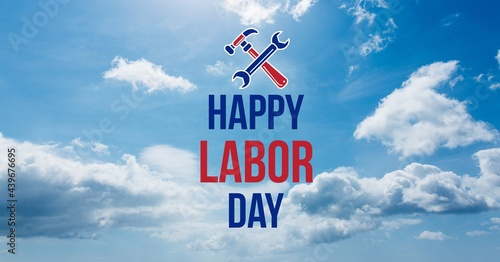 Happy labor day text and tools against clouds in blue sky