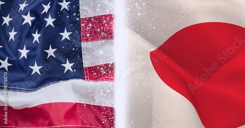 Composition of waving japanese and american stars and stripes flags and central glowing white line