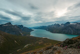 Picturesque fjord in cloudy evening