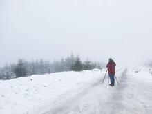 Photographer In Snowy Scene