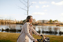 Smiling Mature Woman Riding A Bicycle