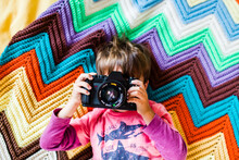Young Boy Holds Camera To His Face