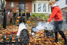 Boy WIth Smoke Machine Scary Halloween Decorations In Front Yard