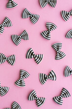 Black And White Striped Pasta Bow Background On Pink