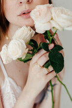 Young Woman In Lingerie With Delicate White Roses