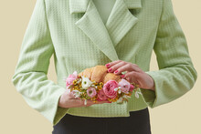 Woman Holding Croissant With Flowers