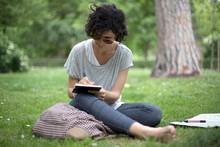 Young Girl Draws At Park