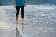 Walking Barefoot Along The Shoreline