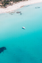Anchored Boat Floating A In Crystal Clear Blue Sea
