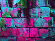 Dark Concrete Blocks With Vibrant Colors Background / Texture