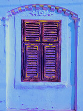 Old Wooden Shutter Fully Closed On A Blue Facade House