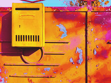 Vibrant Old Golden Yellow Metal Gate With A Striking Mailbox Background