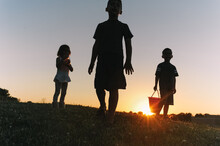 Anonymous Silhouette Of Children Walking.