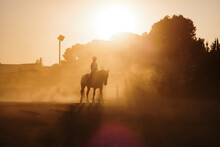 Silhouette Of A Woman Riding A Horse
