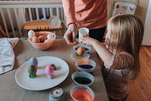 Cute Child And Mother Dyeing Easter Eggs