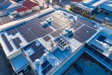 Aerial Views Over Commercial Building With Over 600 Solar Panels Installed