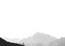 Minimalist Fisherman Fishing In Mountains Landscape