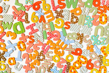 Magnetic Letters And Numbers On White Background