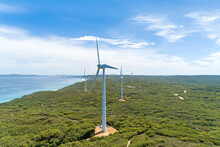 Wind Farm On Top Of Cliffs Along Coastal Strip