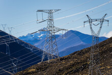 Green Energy Sources Transmission Tower And Snow Mountain