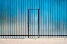 A Door In A Metal Facade.