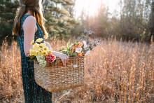 Girl Gathering Spring Flowers