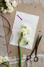 Papers And Flowers With Name Label