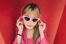 Asian Fashion Woman With Sunglasses And Earphones