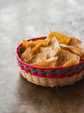 A Basket Of Nachos Or Tortilla Chips