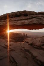 Sunrise Sun Flare At Mesa Arch In Canyonlands National Park In Utah
