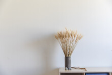 Interior Photo Of A Vase, A Stick And Some Rocks On Top Of A Bookcase