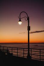 A Street Lamp Near The Ocean.