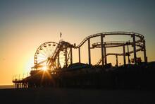A Ferris Wheel Near The Ocean.