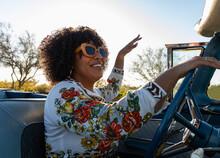 Happy Black Girl Singing In Car On Road Trip
