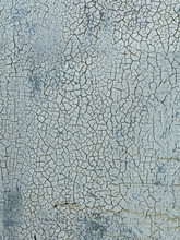 Cracked Surface Of A Blue-gray Painting
