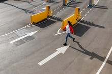 Woman Running On Parking Entrance