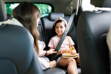 Young Woman Talking With Their Children In The Car