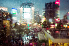 Rain On The Glass And Cityscape As A Background