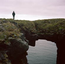 Tourist On Rock Arch