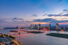 Stunning City Skyline, Full Of Sunset And Rosy Clouds, Just Like A Dream. Above The Ganjiang River, The Bridge Passes Through. Nanchang, China.