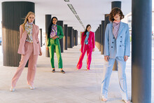 Confident Different Stylish Women Stand Among The Columns