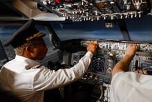 Diverse Pilots Controlling Plane During Flight