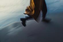 Run Along The Shore In A Coat