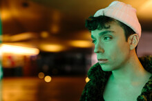 Colorful Side Portrait Of Young Handsome Gay Man Lit By Some Green Light