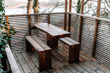 Wooden Table And Benches On Terrace