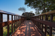 Wooden Bridge Pedestrian Walkway To Big Rock With Small Hold Cave On Forest Hill With Blue Sky, Bridge To Big Rock At Pha Muen Viewpoint Travel Attraction In Khon Kaen, Thailand
