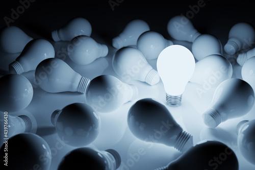 Fototapeta Light bulb bright outstanding among lightbulb on white background