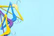 Leinwandbild Motiv Stylish clothes hangers on color background
