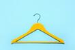 Leinwandbild Motiv Stylish clothes hanger on color background